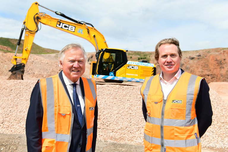 Lord Bamford and son Jo with 20-ton excavator
